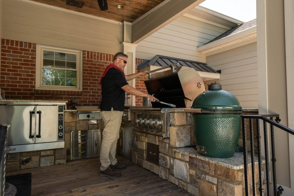 Franklin Stone outdoor kitchen and stone grill alongside Green Egg