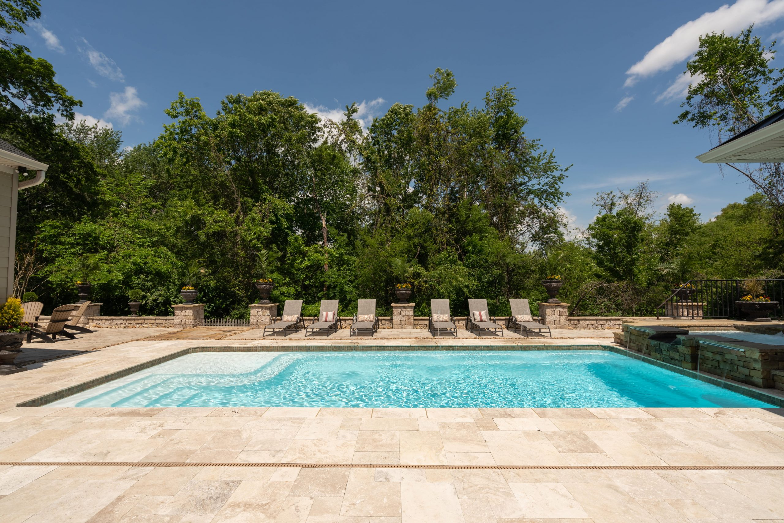 Franklin Stone pool with running water features and lounge chairs