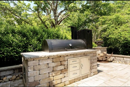 Outdoor grill kitchen stone patio wall backyard