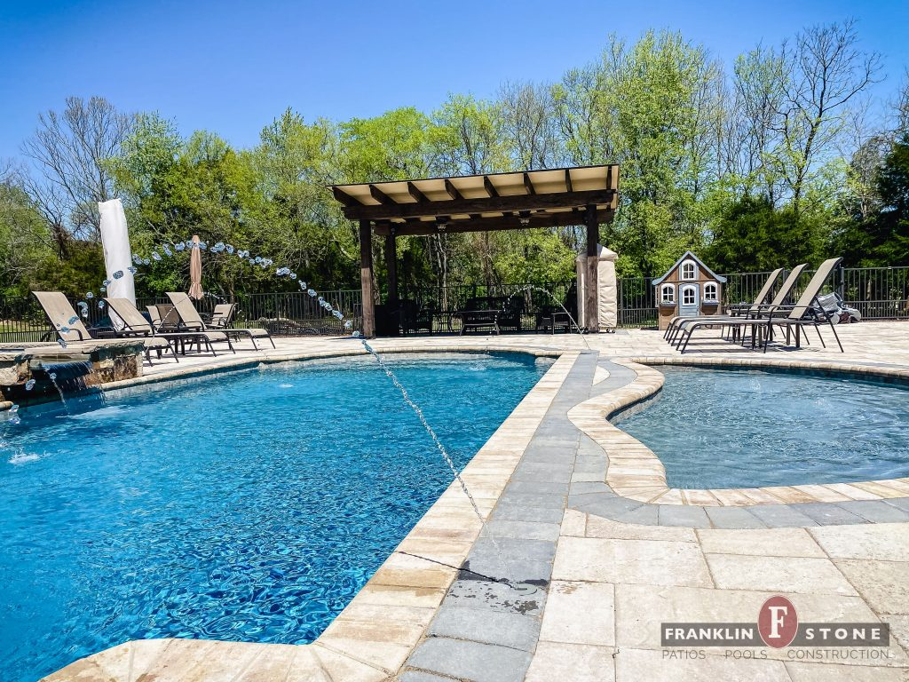 Franklin Stone pergola and pool with running water features