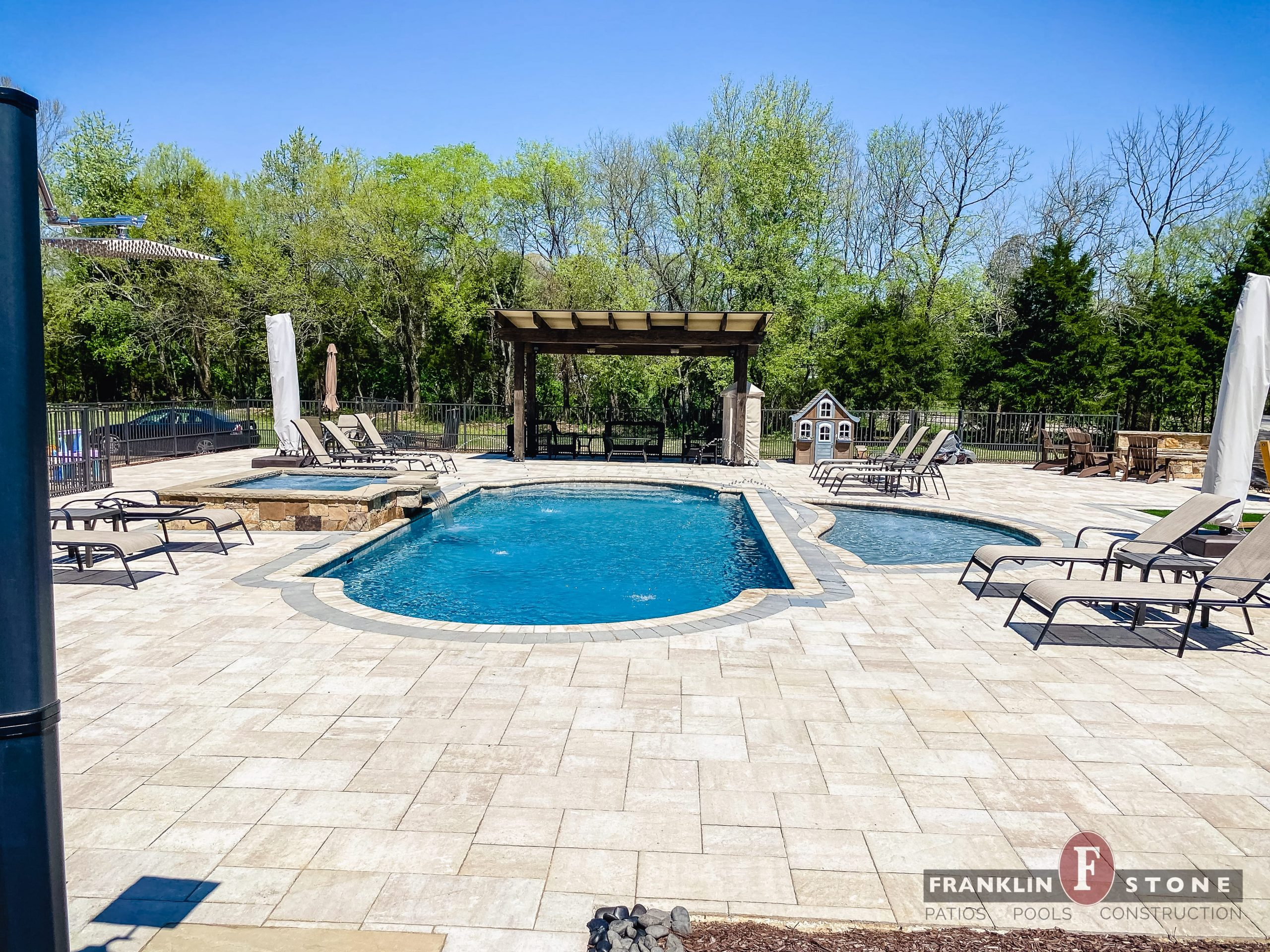Franklin Stone pergola and pool and spa with running water features