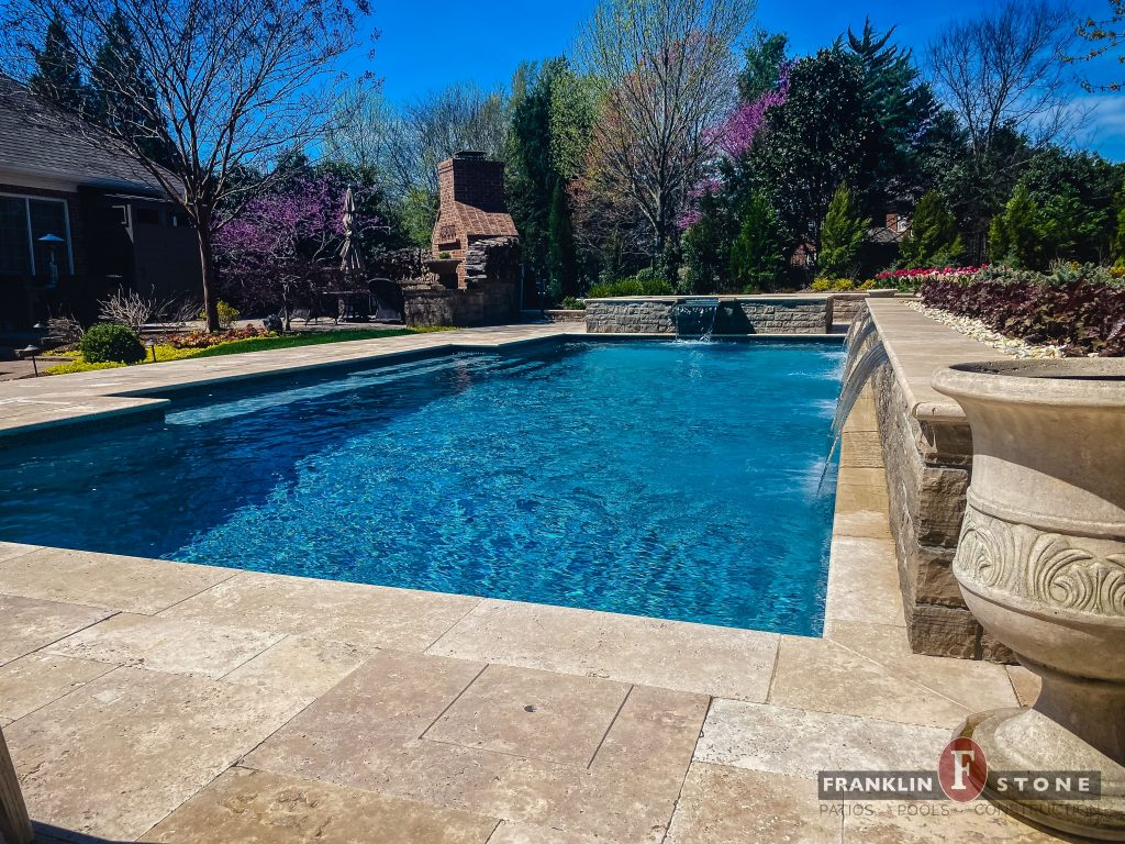 Franklin Stone pool and stone spa with running water features
