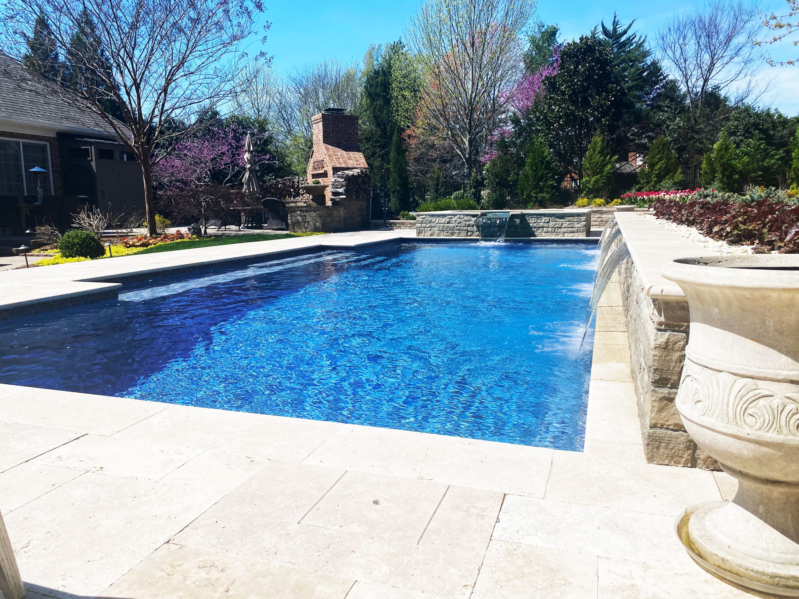 Franklin stone pool and spa with running water features