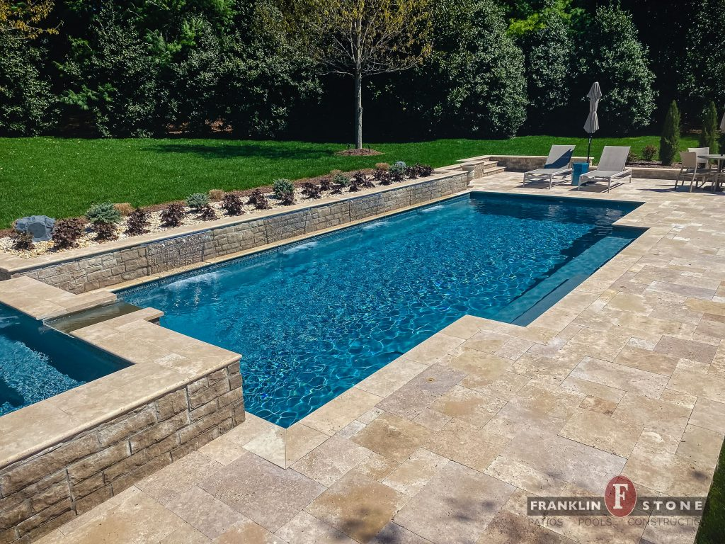 Franklin Stone stone spa and pool with running water features