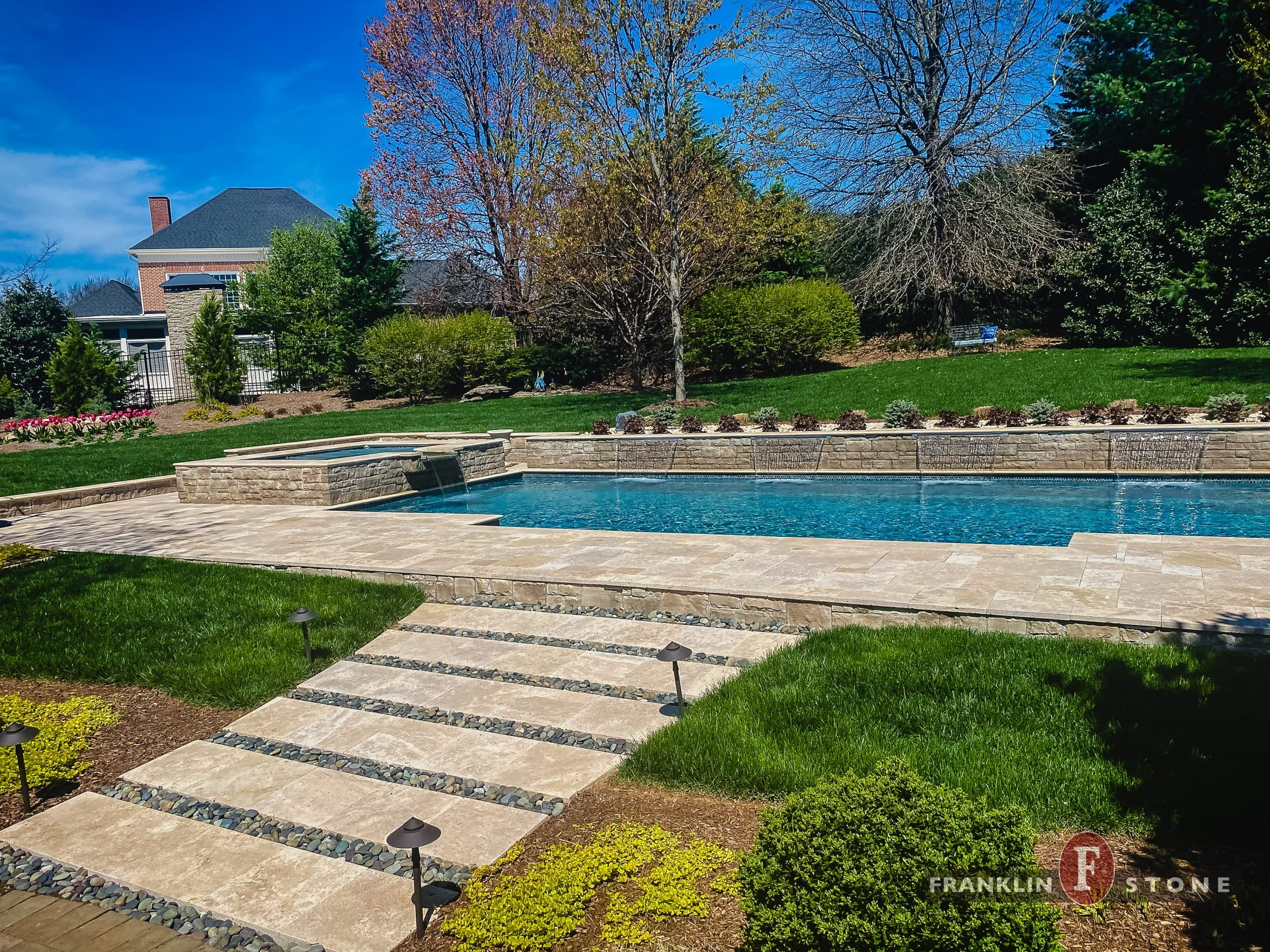 Franklin Stone walkway to pool and spa with running water features