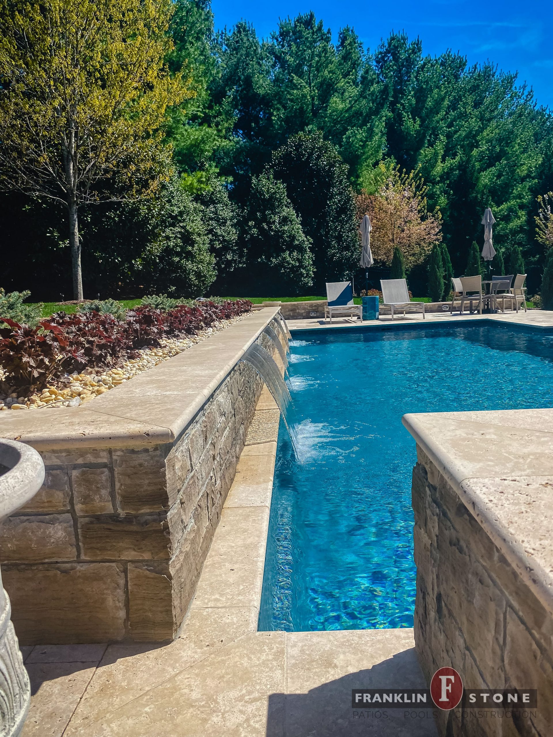 Franklin Stone pool with running water features