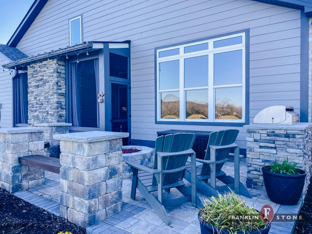 Franklin Stone outdoor patio with stone firepit and chairs
