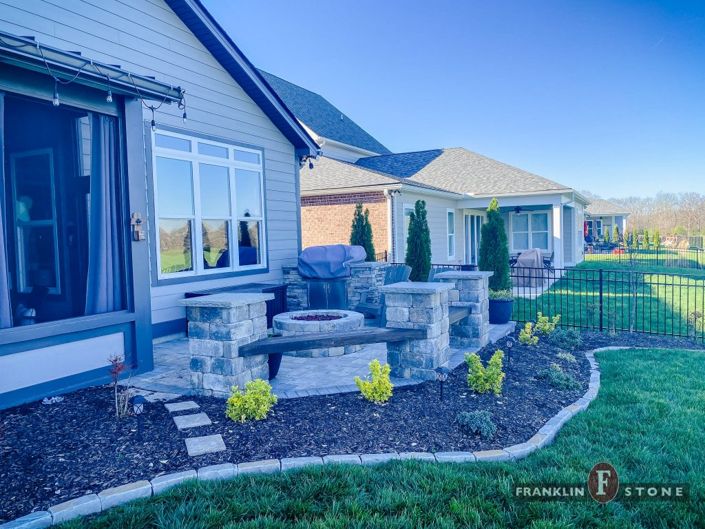 Franklin Stone outdoor patio with stone firepit and grill