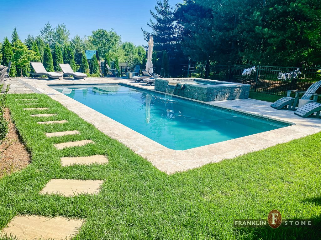 Franklin Stone walkway and pool and stone spa with running water features