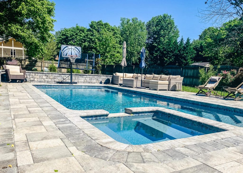 Franklin Stone outdoor pool and spa with outdoor seating areas and basketball hoop