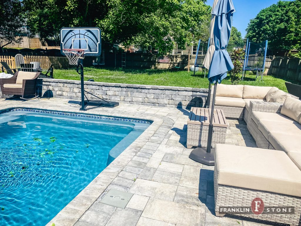 Franklin Stone pool, outdoor patio furniture, and basketball hoop