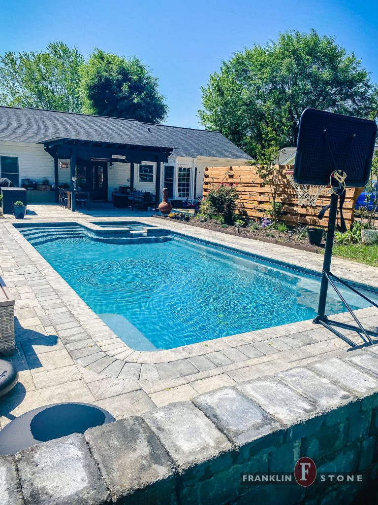 Franklin Stone pool and spa with basketball hoop