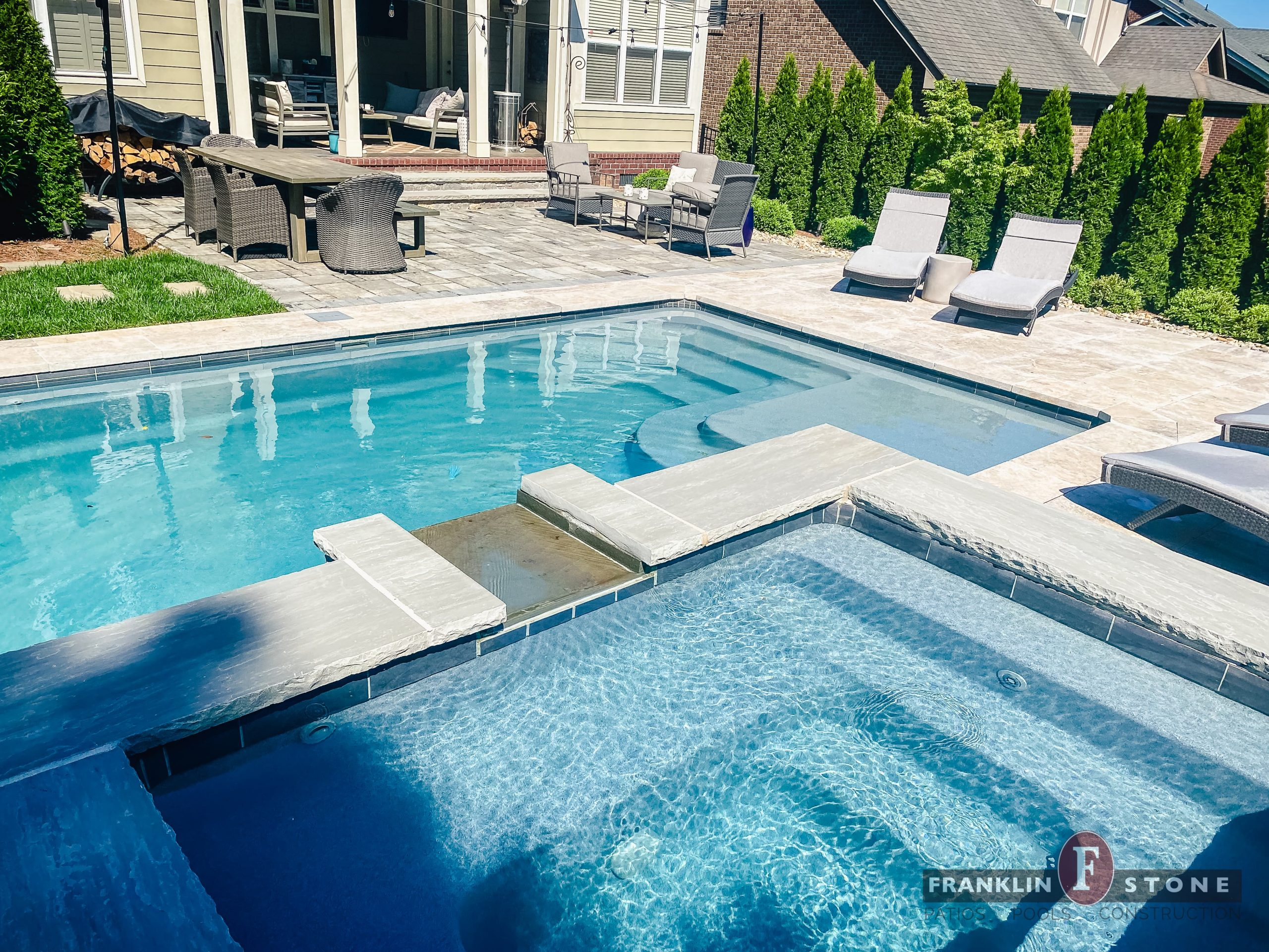 Franklin Stone pool, spa, and outdoor patio seating